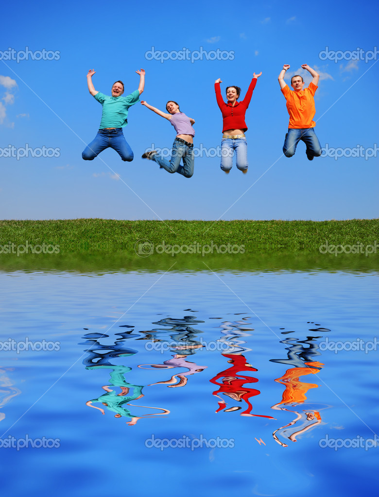 Jumping against blue sky with reflection on water — Stock Photo #1571497