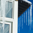 Melting Icicles against sky background - Stock Photo