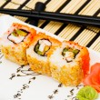 Sushi (rolls) on a plate - Stock Photo