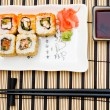 Sushi (rolls) on a plate — Stock Photo