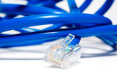 Isolated blue ethernet cable — Stock Photo