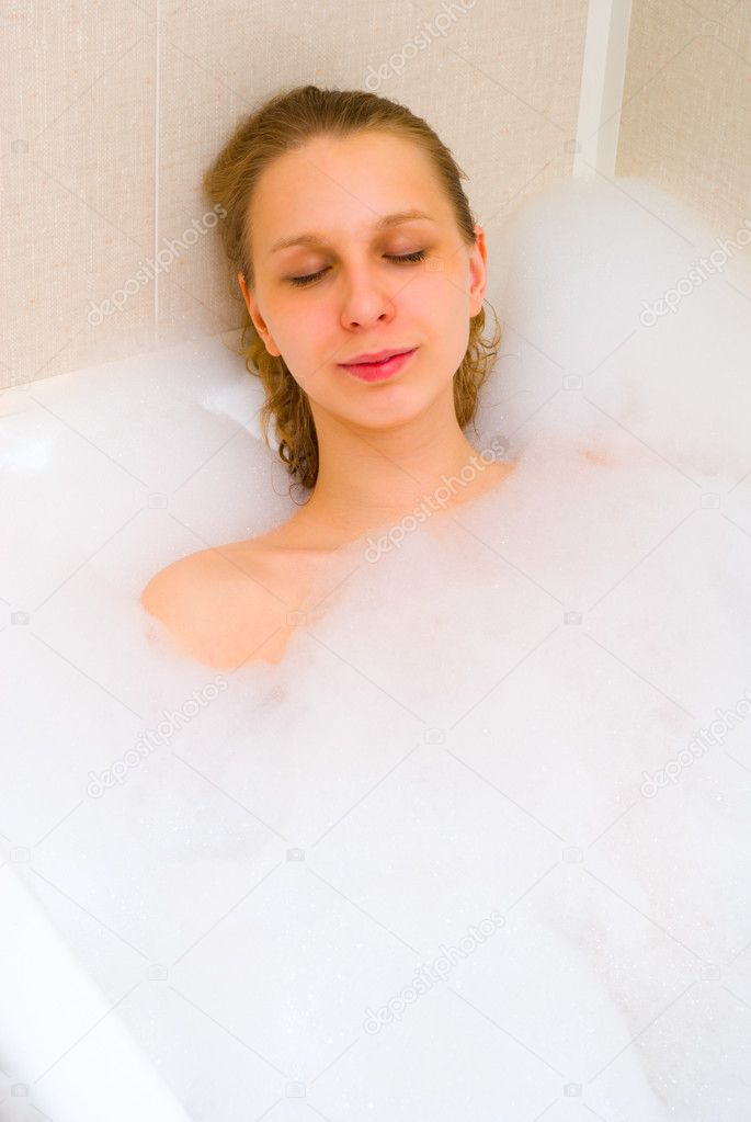Girl laying in bath foam — Stock Photo #1586008