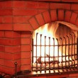Fireplace with iron lattice — Stock Photo
