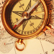 Antique brass compass over old map — Stock Photo #1595422