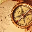 Antique brass compass over old USA map - Stock Photo