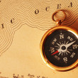 Antique brass compass over old USA map — Stock Photo #1595481