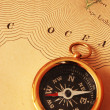 Antique brass compass over old USA map — Stock Photo #1595487