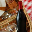Picnic basket with wine and glasses — Stock Photo