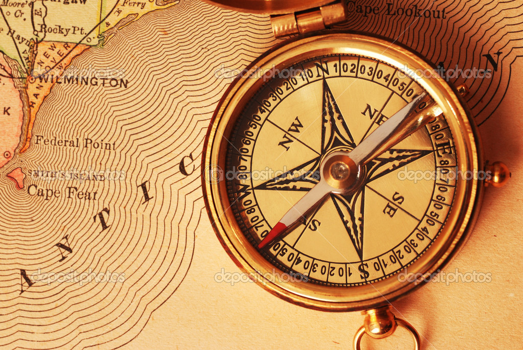 Antique brass compass over old map background                                      Stock Photo #1595477