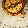 Stock Photo: Antique brass compass over old Canadian