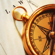 Antique brass compass over old Canadian — Stock Photo