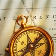 Antique brass compass over old Canadian — Stock Photo #1623653