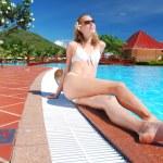 Girl near pool — Stock Photo