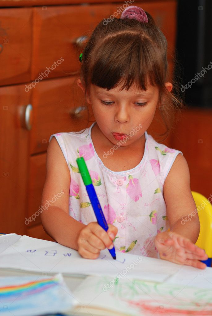 Little cute preschool girl drawing  Stock Photo #1622859
