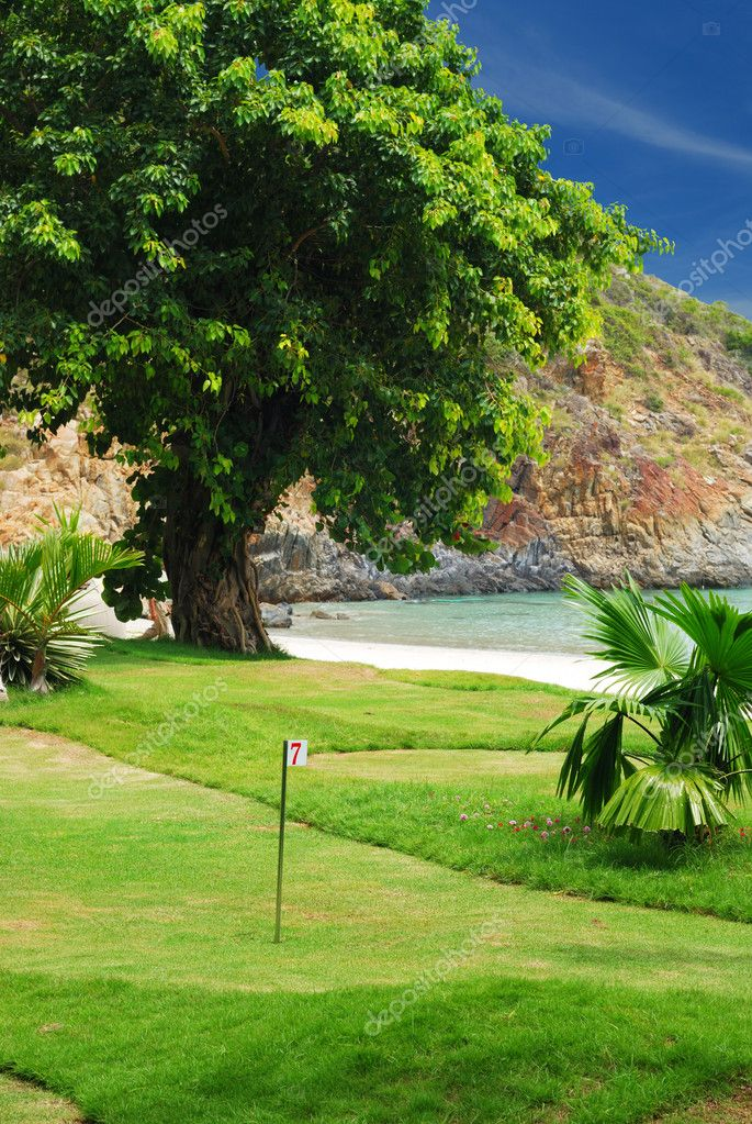 Golf field near tropical resort — Stock Photo #1624124