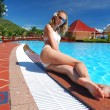 Girl near pool — Stock Photo #1656530