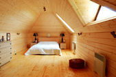 Wooden bedroom — Stock Photo