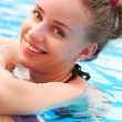 Girl in tropical pool — Stock Photo