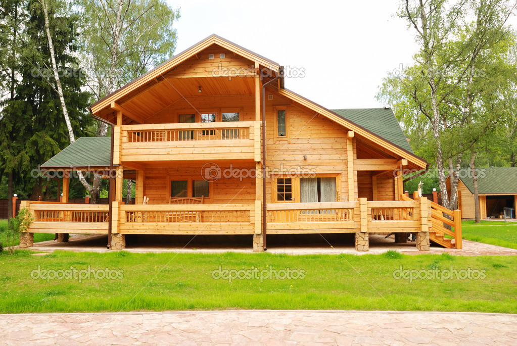 Wooden house with meadow in front of it  Stock Photo #1693225