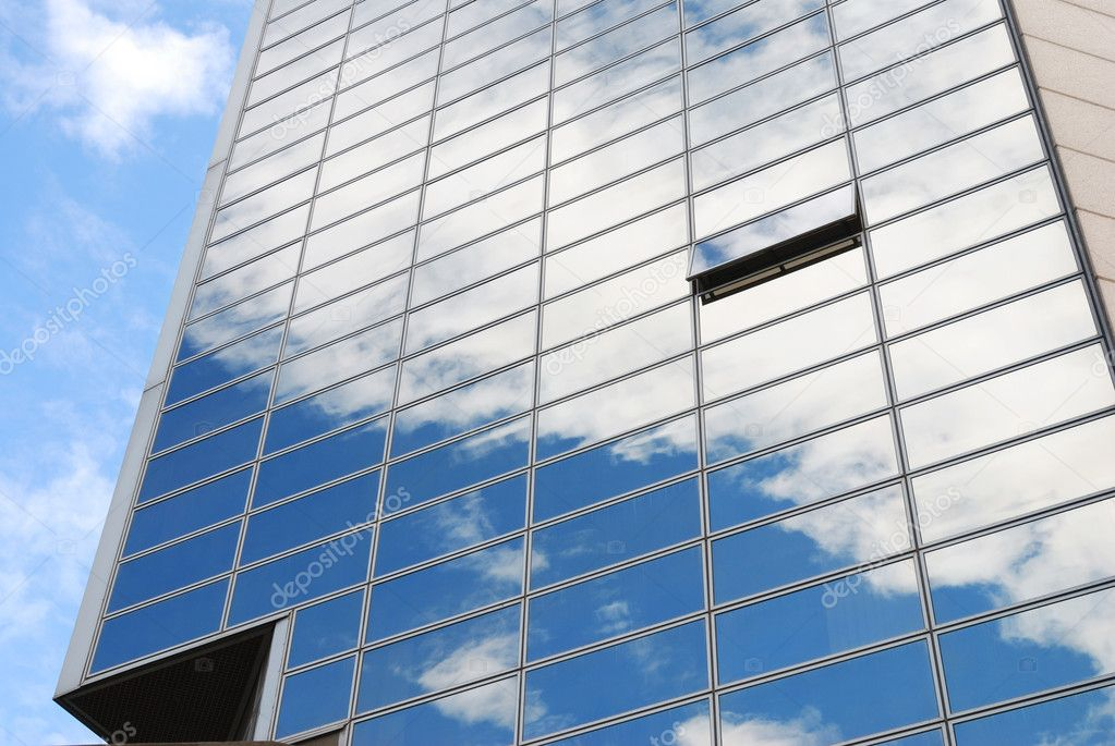 Modern office building with sky reflection in windows — Stok fotoğraf #1705876