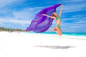 Jump with sarong — Stock Photo