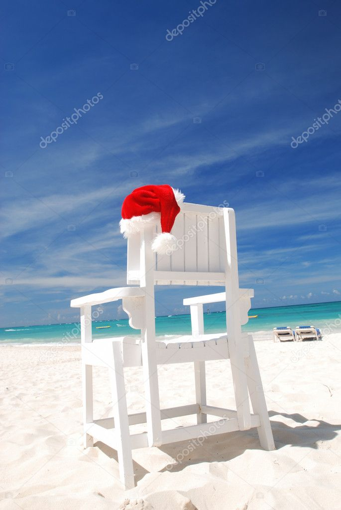 Santa's hat and chair on the beach  Stock Photo #1716859
