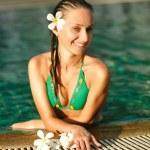 Girl in pool — Stock Photo #2506258