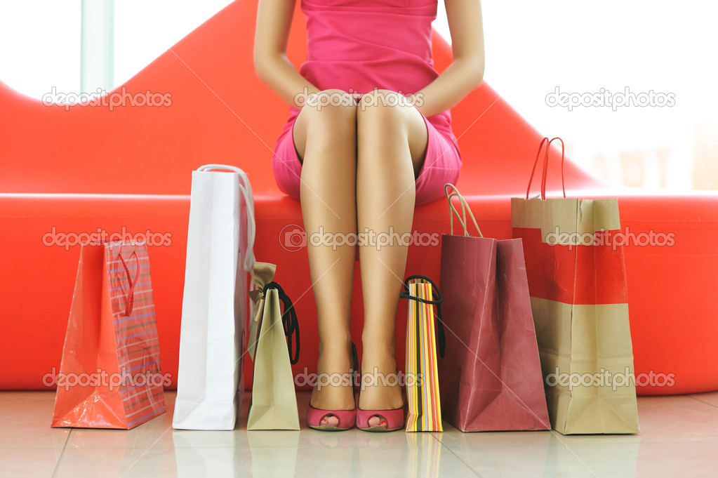 Woman with bags in shopping mall — Stock Photo #2506358