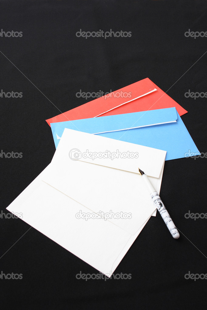 Multi-coloured envelopes and the pen on a black background  Stock Photo #1250743