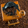 Coffebeans and grinder — Stock Photo