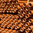 Stacked PVC orange pipes — Stock Photo #1201846