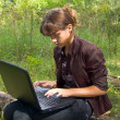 Web browsing in forest — Stock Photo