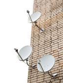 Three satellite antennas — Stock Photo