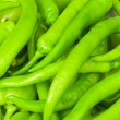 Royalty-Free Stock Photo: Many green hot peppers arranged at the m