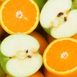 Close up of half cut oranges and apples — Stock Photo #1244137