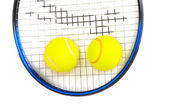 Two tennis balls and racquet isolated — Stock Photo