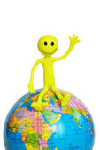 Smilie sitting on the globe — Stock Photo