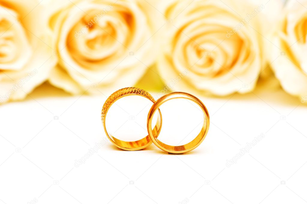 Roses and wedding rings isolated on the white  Stock Photo #1244254