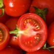 Half cut and whole tomatos at the martke — Stock Photo #1252799