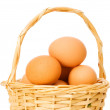 Basket full of eggs isolated on white — Stock Photo #1256101
