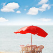 Royalty-Free Stock Photo: Table, chairs and parasol on  the beach