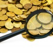 Royalty-Free Stock Photo: Magnifying glass and lots of gold coins