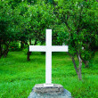 Cross at the grave — Stock Photo