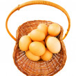 Basket full of eggs isolated on white — Stock Photo