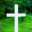 Cross at the grave — Stockfoto