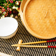 Royalty-Free Stock Photo: Chopsticks and bowl on the bamboo mat