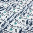 Stack of dollars on money background — Stock Photo