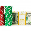 Dollar and casino chip stacks on white — Stock Photo