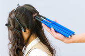 Hairdresser with plait-maker and girl — Stock Photo
