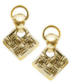 Pair of earrings isolated on the white — Stock Photo
